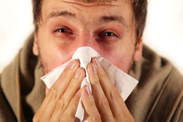 Sneezing, a possible symptom of allergies